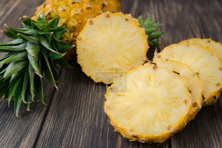 Photo for Fresh organic pineapple on a wooden rustic table - Royalty Free Image