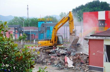 Excavator demolition house