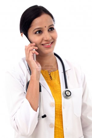 Young female doctor talking on mobile phone