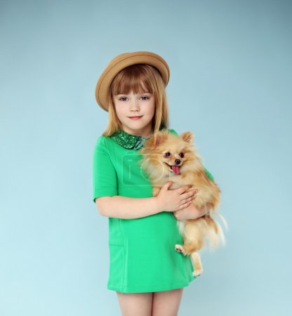 Photo for Attractive beautiful girl with holding little sweet dog - Royalty Free Image