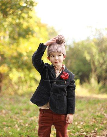 Boy at autumn park