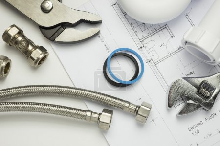 Plumbing tools and parts on house plans