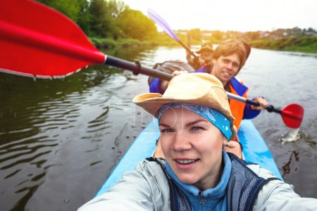 Selfie. Young people are kayaking on a river in beautiful nature.