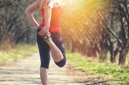 Sport woman jogging outside in morning