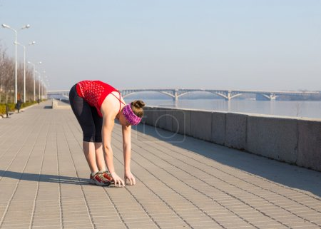 Fitness woman doing exercises during outdoor cross training workout