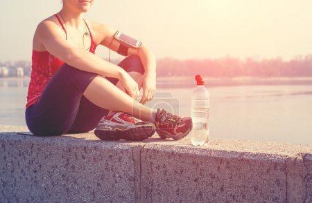 Sport woman relax during training outside in morning