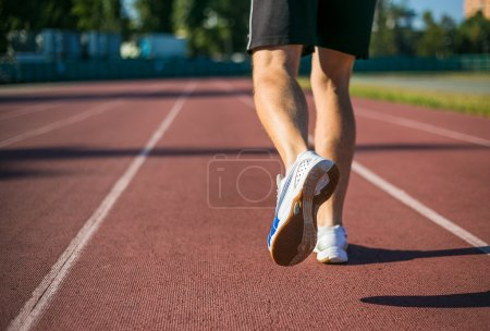 Man running on city stadium