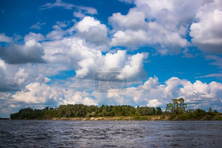 River with trees and clouds