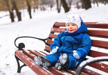 boy playing in winter park