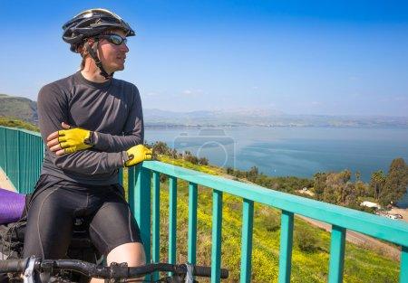 Happy biker near sea of Galilee