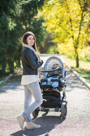 Woman with stroller going for a walk