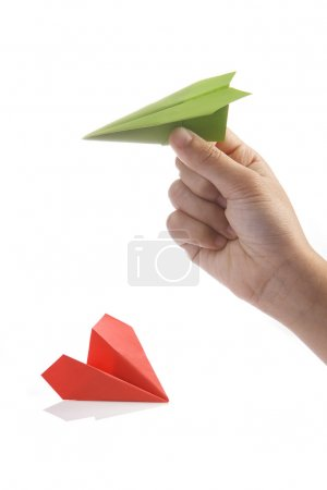 Paper plane in hand. Start up business concept