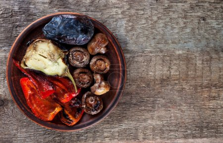 Mix roasted vegetables on a plate top view
