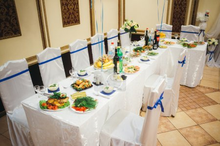 set up tables for the guests at the wedding