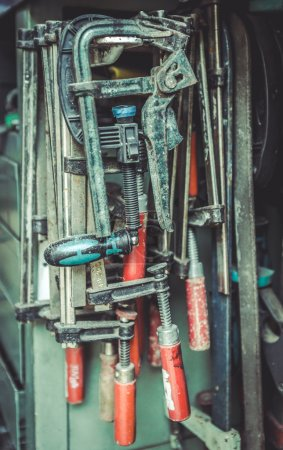 Old clamps at repair service. Garage concept