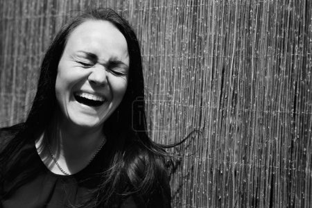 a beautiful young girl laughing. Black and white