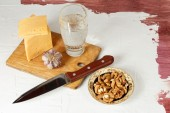 Still life with cheese, garlic, walnuts and mineral water