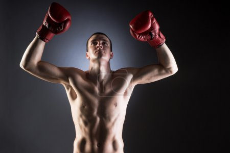Fighter in red gloves. Victory.