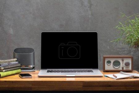 Laptop on wooden worktable