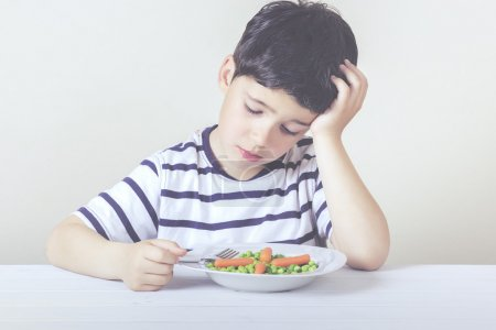 Photo for Sad child with a meal - Royalty Free Image