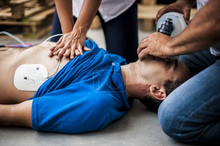 rescuers assisting unconscious man