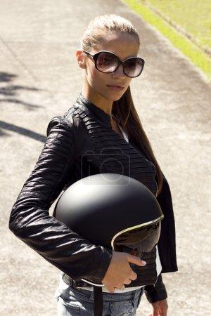 Beautiful woman in black leather