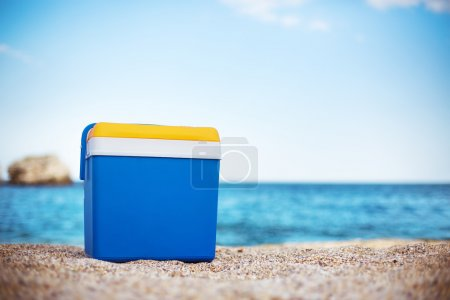 Cooler box on the sand beach