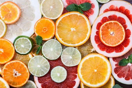 Sliced citrus: oranges, mandarines, lemons, limes, sweetie, grapefruits, witch's broom close-up macro