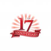 17th anniversary ribbon logo with red rays of light