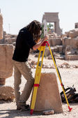Surveyor working on restoration project