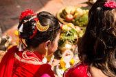 Young girls symbolic wedding ceremony.