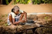 An elderly woman fishing