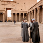 EDFU, EGYPT - NOVEMBER 28, 2011: Guides sharing th...