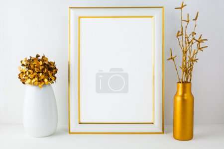 Frame mockup with white and golden vases