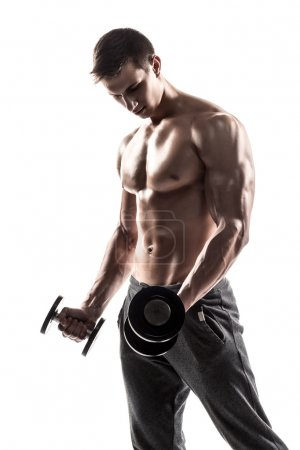 Handsome muscular man doing exercises with dumbbel...