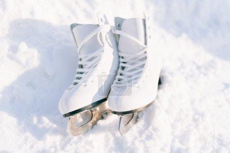 Figure skates in snow close-up