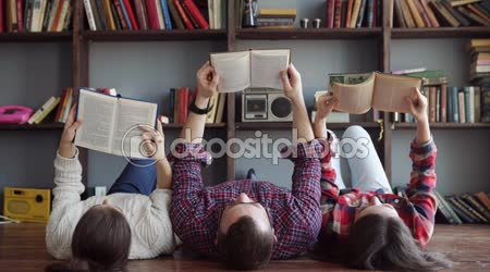 Group of students reading book at school