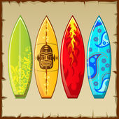 Four bright surfboards with different pattern