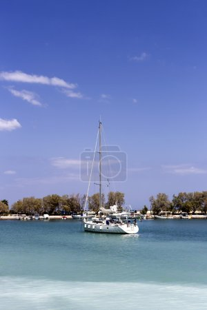 The view of the sea and moored yacht on a sunny da...