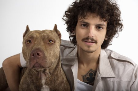 young man with Pit bull dog