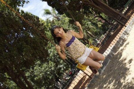 pretty little girl swinging