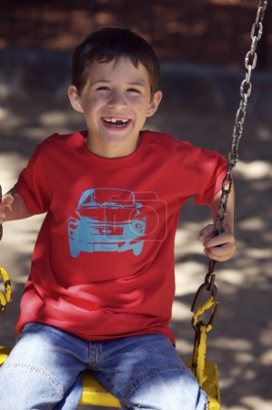 small boy swinging