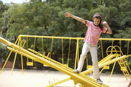girl fooling around on playground