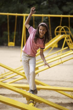 Photo for Small pretty girl fooling around on playground - Royalty Free Image