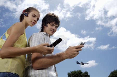 teenagers using gadgets