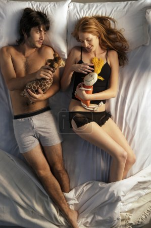 attractive young couple in bed