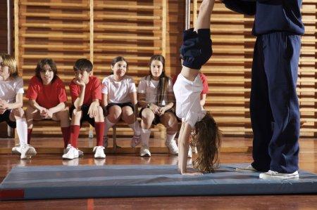 Group of children doing gymnastics