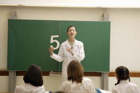 Female teacher teaching a lesson