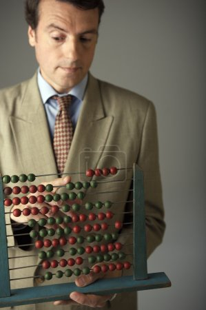 Man holding an Abacus