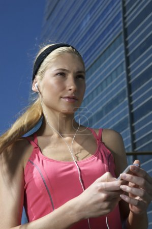 woman listening to an MP3 player